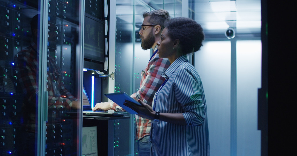 IT professionals accessing server